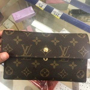 Louis Vuitton Porte Tresor international wallet.